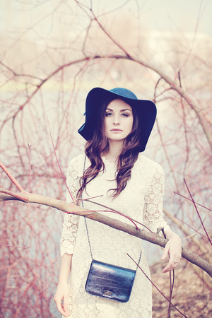 gentle dream vacation: Beautiful Lady in a Hat in the Spring. Woman Outdoors