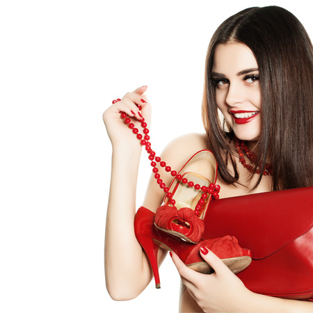 Shopaholic Girl with Red Jewelry, Shoes and Handbags Isolated Stock Photo