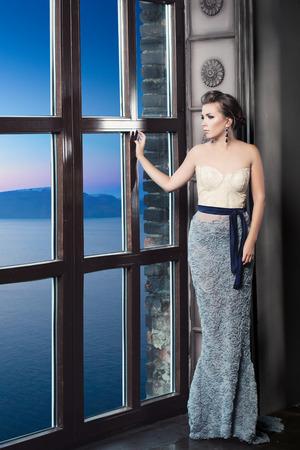 Beautiful Woman Posing and Looking at the Sea view