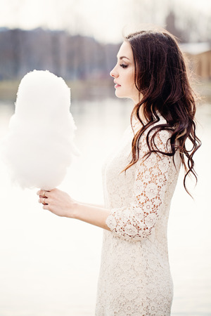 Sensual Woman with Candy Floss. Brunette Fashion Model Outdoors