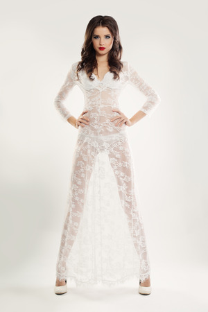 negligee: Fashion Woman in White Lace Dress