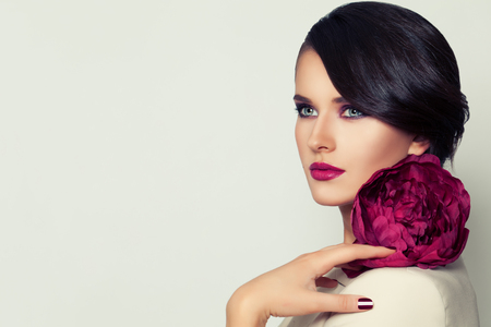 Elegant Woman Fashion Model with Burgundy Lips Makeup and Peony Flower 写真素材
