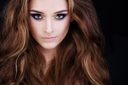 Glamorous Woman with Long Permed Hair and Smokey Eyes Makeup