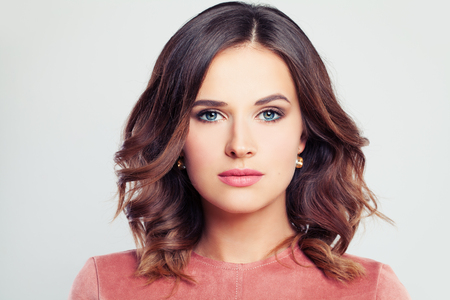 Perfect Beauty. Beautiful Woman Fashion Model with Makeup and Curly Hairstyle