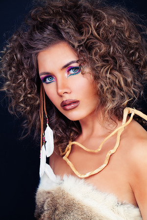 Beautiful Female Face. Stylish Woman Fashion Model with Curly Hairstyle and Makeup