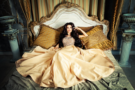 Glamorous Brunette Woman in Fashionable Dress