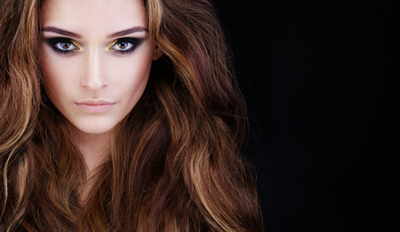 Beautiful Face. Woman Fashion Model with Makeup and Brown Curly Hair on Black Banner Background