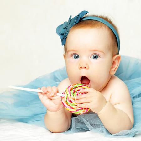 Sweet Baby girl with lollipop, happy birthday card