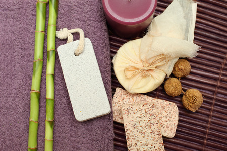 Spa and bath background with handmade soap, bamboo, bag of massage oil Stock Photo