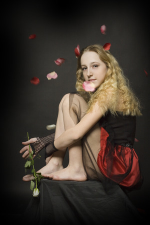 roseleaf: Young girl with rose on dark background