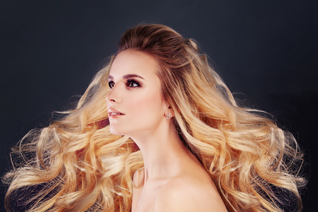 Beautiful Blonde Hair Woman Fashion Model with Permed Curly Hairstyle and Makeup