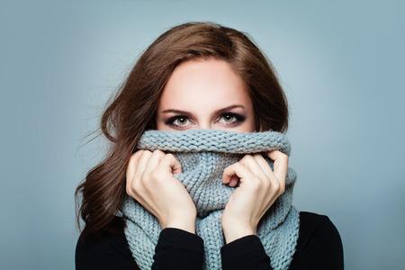 Trendy Woman in Wool Winter Scarf. Beauty Winter Girl Fashion Model in Knitted Woolen Cloth Stock Photo