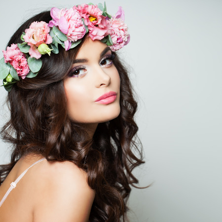 Perfect Woman Fashion Model with Healthy Skin and Flowers Wreath. Spring Beauty Stock Photo