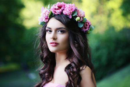 Beautiful Girl with Spring Flowers Outdoor