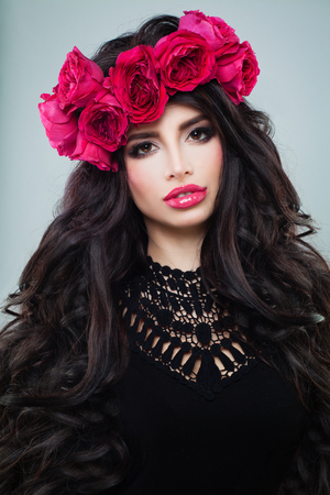 Beautiful Woman Fashion Model with Long Curly Hair and Roses Wreath