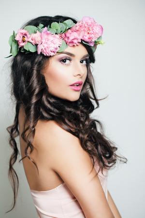 Beautiful Woman Fashion Model with flowers