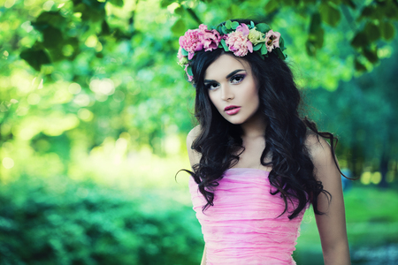 Nice Woman in Spring. Beautiful Model with Flowers Outdoor Stock Photo