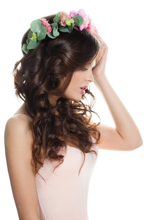 Young Woman Fashion Model with Healthy Skin and Flowers Wreath Isolated on White. Profile