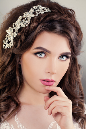 Closeup Fashion Portrait of Yound Beautiful Woman Fiancee. Bride with Bridal Hairstyle, Event Makeup and Jewelry