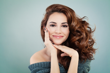 Beautiful Smiling Model Woman with Wavy Hairstyle. Cosmetology and Treatment Concept Stock Photo