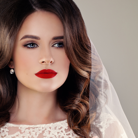 Beautiful Bride Fashion Model, Closeup Wedding Portrait. Woman Fiancee with Curly Hairstyle and Event Makeup on Background with Copy Space Stock fotó