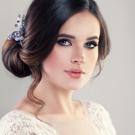Young Woman Fiancee with Bridal Hairstyle, Natural Makeup and Jewelry 写真素材