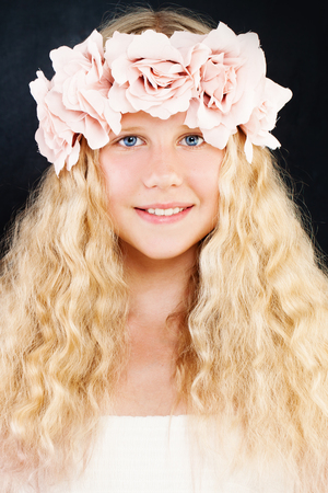 Young Beauty. Young Girl with Long Blonde Hair and Rose Flowers Wreath. Teen Girl Stock Photo