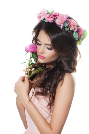 Fashion Model Woman Holding a Flower. Long Permed Curly Hair, Fashion Makeup and Pink Dress