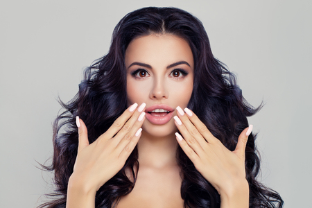 Surprised Woman Fashion Model with Open Mouth. Brunette Girl with Long Hair and Healthy Skin. Beauty, Facial Treatment and Cosmetology