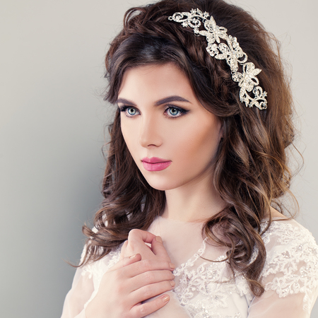 Beauty Fashion Portrait of Young Bride with Wedding Hairstyle and Makeup