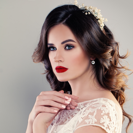 fiancee: Perfect Portrait of Beautiful Bride with Wedding Hairstyle and Red Lips Makeup