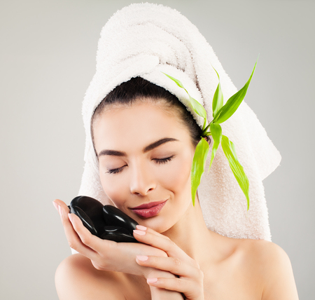 woman bath: Spa Model Woman with White Bath Towel and Natural Green Leaves. Healthcare, Skincare and Spa Concept