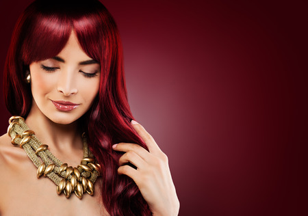 Fashion Model Woman with Red Curly Hair. Beautiful Redhead Girl on Banner Background Stock Photo