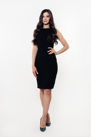Fashion Model Woman in Black Dress. Beautiful Young Woman 免版税图像