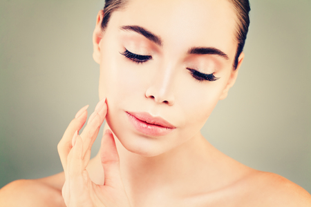 Spa Model Woman with Healthy Skin touching her Hand her Skin. Skincare, Facial Treatment and Cosmetology Stock Photo