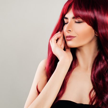 Glamorous Woman with Red Curly Hair. Beautiful Redhead Model, Pretty Face Stock Photo