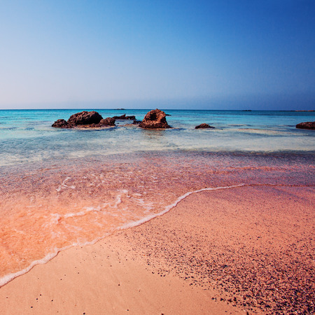 Crete, Greece. The Wave of the Sea on the Pink Sand on Beautiful Beach. Pink Sand Beach of Famous Crete Island Elafonisi (or Elafonissi) 스톡 콘텐츠
