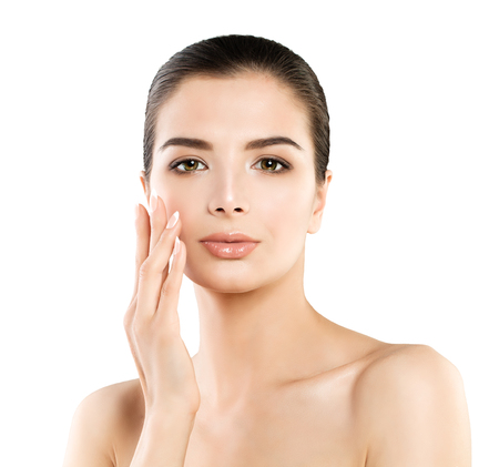 Cute Spa Model Woman with Healthy Skin Touching her Hand her Face. Spa Beauty, Facial Treatment and Cosmetology Concept Standard-Bild