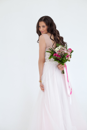 Beautiful Bride Woman Fashion Model with Colorful Flower Arrangement Stock Photo