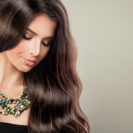 Perfect Beauty. Young Beautiful Woman Fashion Model with Long Curly Hair and Makeup Фото со стока - 85002424