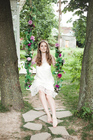 Young Model Woman in Garden Outdoors Stock Photo