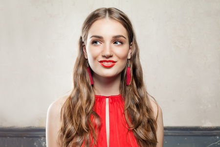 Beautiful Surprised Fashion Model Woman with Makeup Wearing Red Cloth Stock fotó