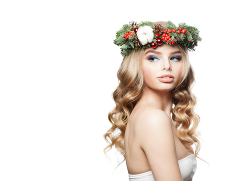 New Year Lady Fashion Model with Wavy Hair, Makeup and Christmas Wreath Isolated on White Background Stock Photo