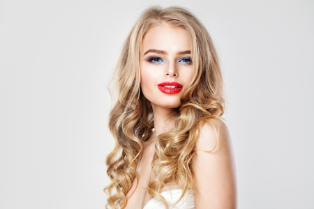Nice Young Woman with Makeup and Blonde Wavy Hair. Portrait of Cute Girl