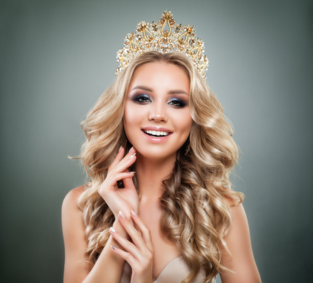 Smiling Woman Fashion Model with Makeup, Blonde Wavy Hair and Golden Crown