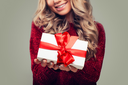 White Gift Box with Red Ribbon in Female Hand Stock fotó