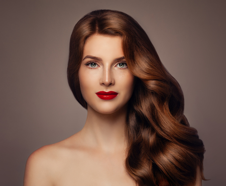 Young Woman with Long Healthy Wavy Hairstyle. Girl with Colored Hair, Haircare Concept