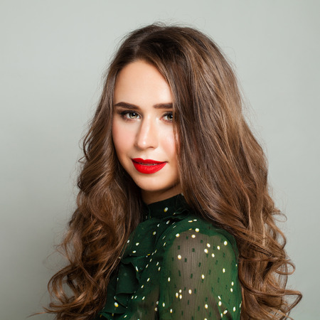 Young Woman with Long Healthy Hair. Real Girl in Green Blouse