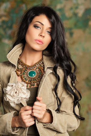 Perfect young brunette woman portrait. Brunette hair model in beige corduroy jacket Stock Photo