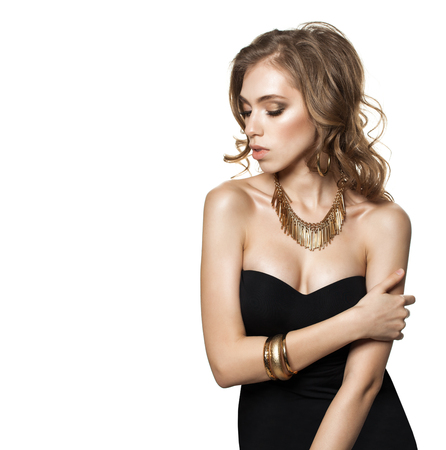 Beautiful Young Woman Fashion Model with Wavy Brown Hair and Gold Jewelry Necklaces Isolated on White Background Imagens